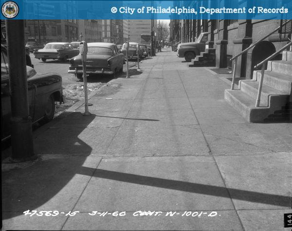 Cont. W-1001-D - Spring Garden Street-North Side - 13th Street to 12th Street: Sidewalk 1217-1221 Spring Garden Street West.